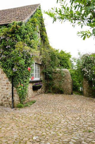 Coming into the shared courtyard, turning sharp right takes you through the pedestrian gate and into the private garden of the cottage.