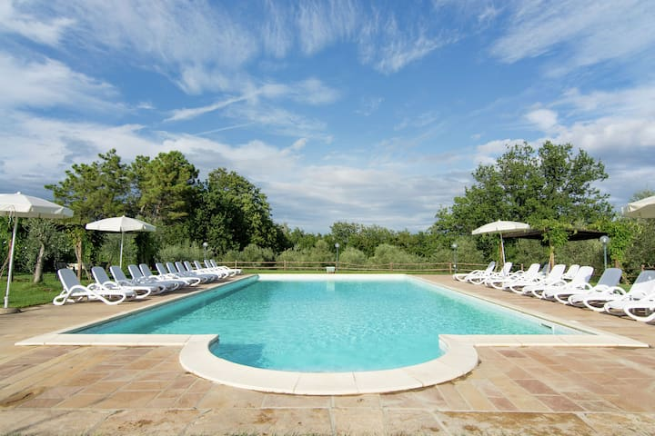 A small village of five beautiful apartments in the green Tuscan hills.