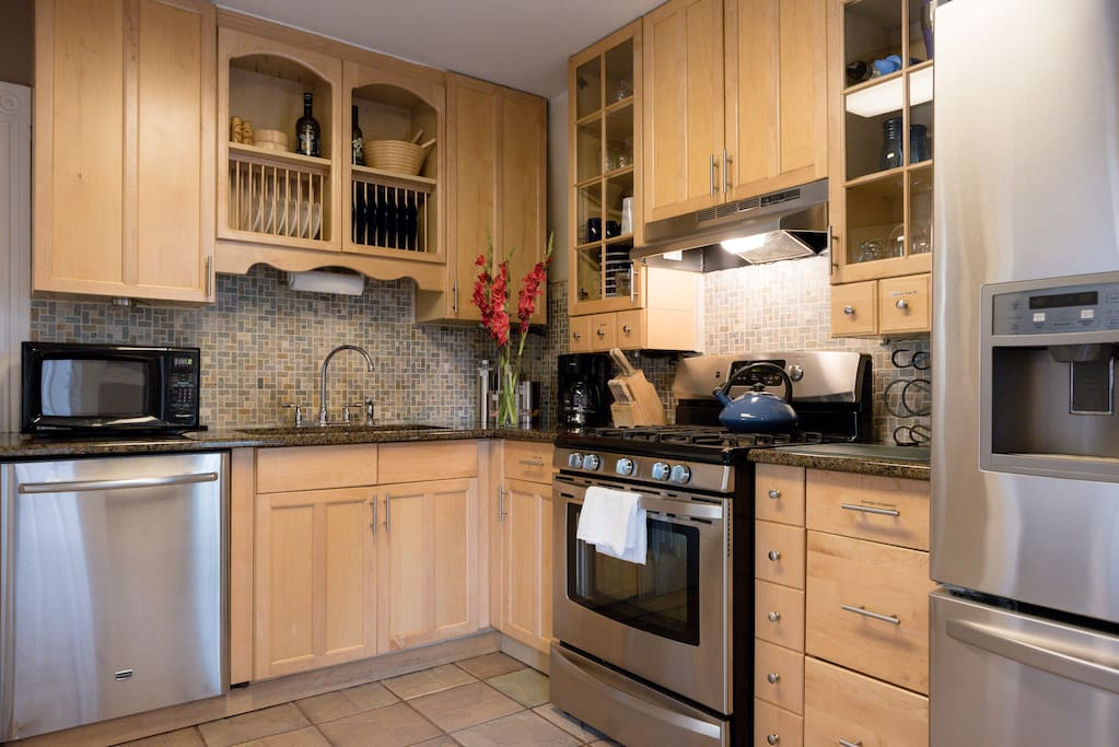 Updated kitchen with granite countertops, stainless steel appliances, complete dishware, cooking supplies and stocked coffee station.