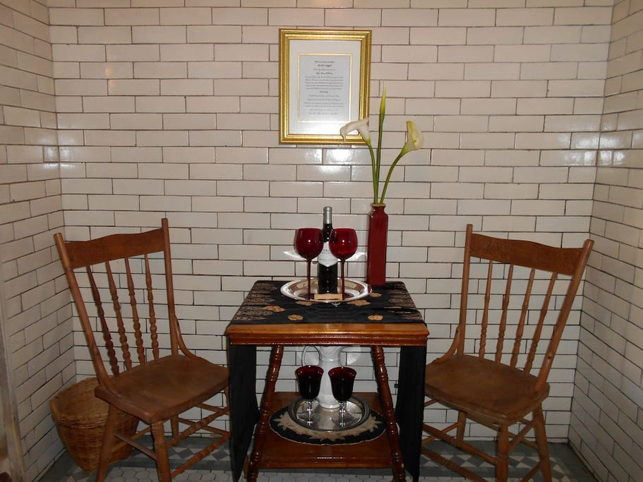 "The seating area, complete with a bottle of ""Bloodeaux"" wine"