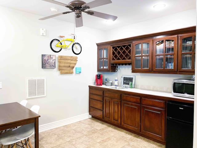 Fun bicycle themed art accents your kitchenette and dining area with everything you need!