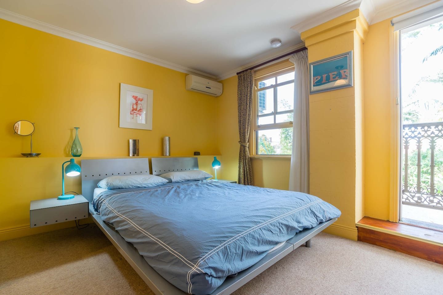"""The master bedroom features a queen-size bed with quality linen, ample storage, aircon/heating and a Juliette balcony (for a fresh breeze). """"The bed in main room was super comfy. Maybe one of the most comfy beds I've ever slept in.""""(Katie, guest)."""
