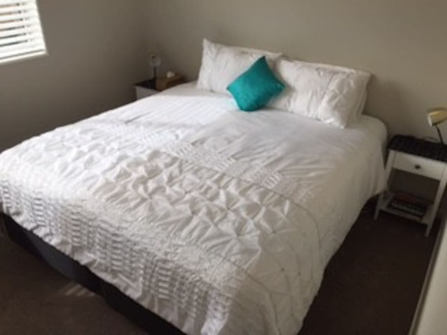 Private guest room with King-size bed + ensuite and small lounge.