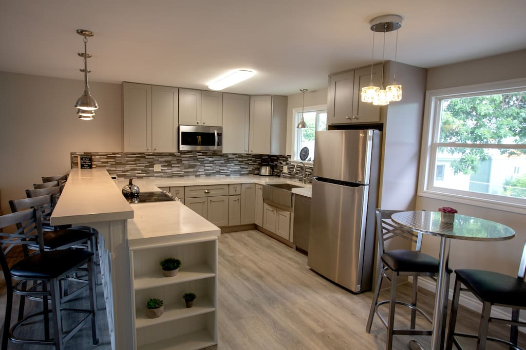 Upgraded LG appliances, concrete countertops, trash compactor, Microwave/convectional