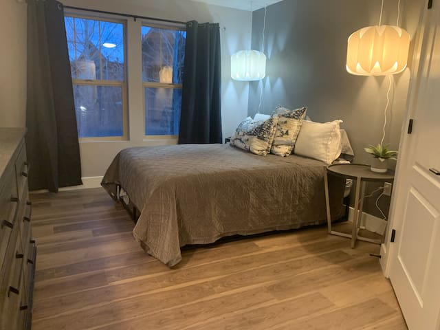 Ensuite bedroom with a new queen bed