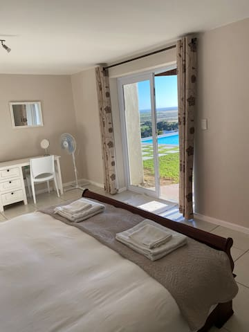 King size bed in main room with beautiful view.