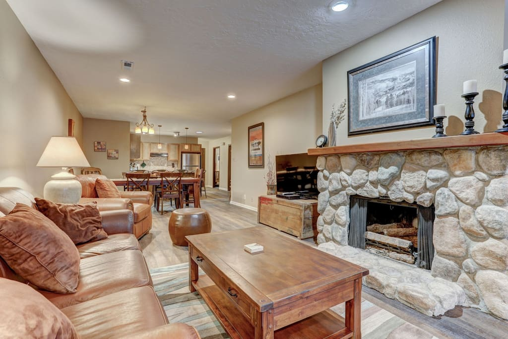 """Living Room with 60"""" HD Smart TV, Gas Fireplace and Sofa Pull Out"""