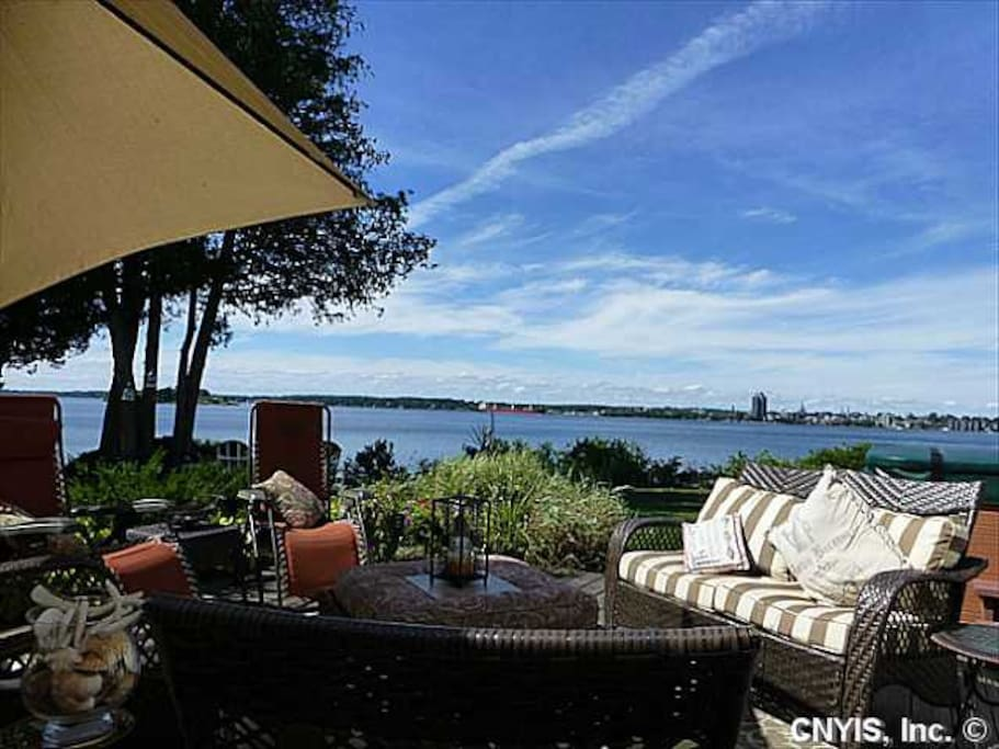 Another wrap-around deck with comfortable outdoor seating for lots of people, and of course a great waterfront view!