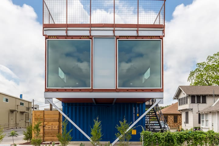 The red container is an upstairs workspace (not included with booking)