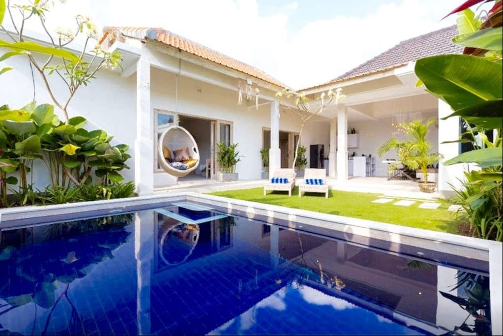 Bright and breezy open plan villa with pool and lush garden in a quiet side street, moments from Seminyak beach and one of its most popular streets.
