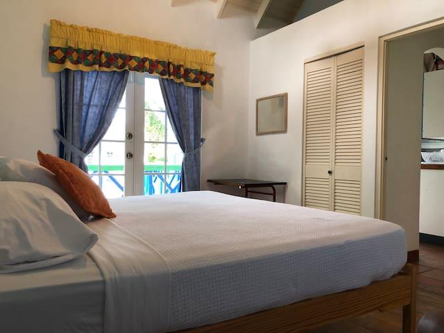 First floor En suite Second Bedroom with window over looking the pool....