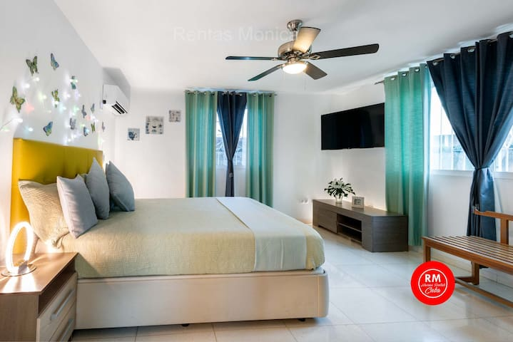 bedroom #2 on the lowest level with king size bed, air conditioner, closet, safe for money a documents and tv.