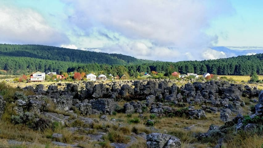 The tranquil little village of Kaapsehoop in the background with it's weird rock formations in the foreground.