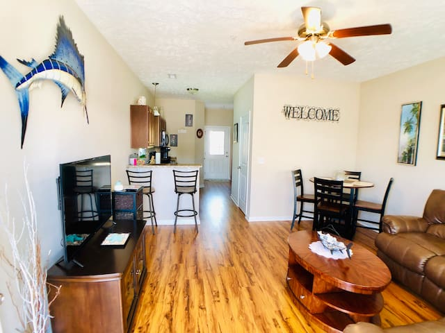 The adjoined living and dining room with comfortable furnishings and entertainment for your stay