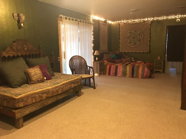 Common area with queen bed