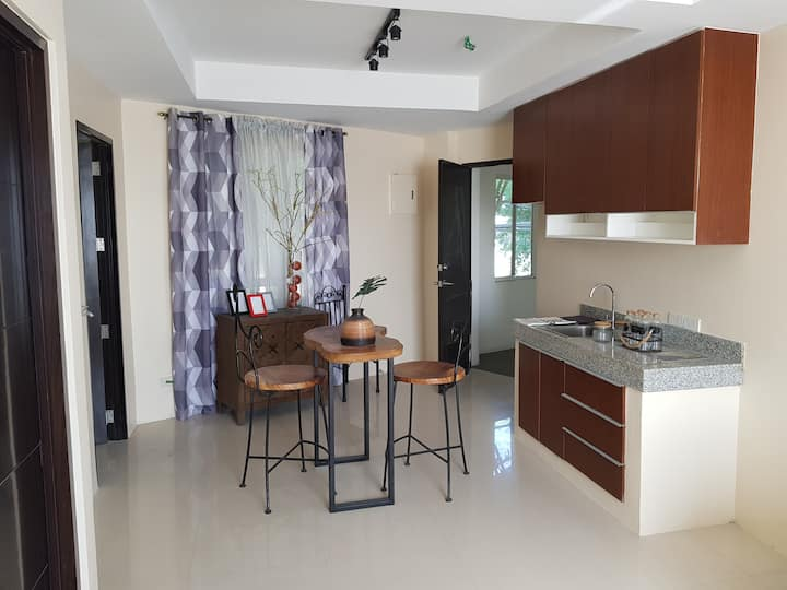 1BR Condo: Modern Style with Swimming Pool
