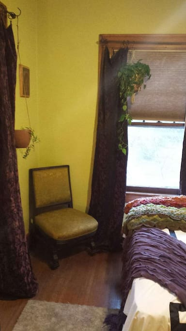 guest bedroom with reading chair.