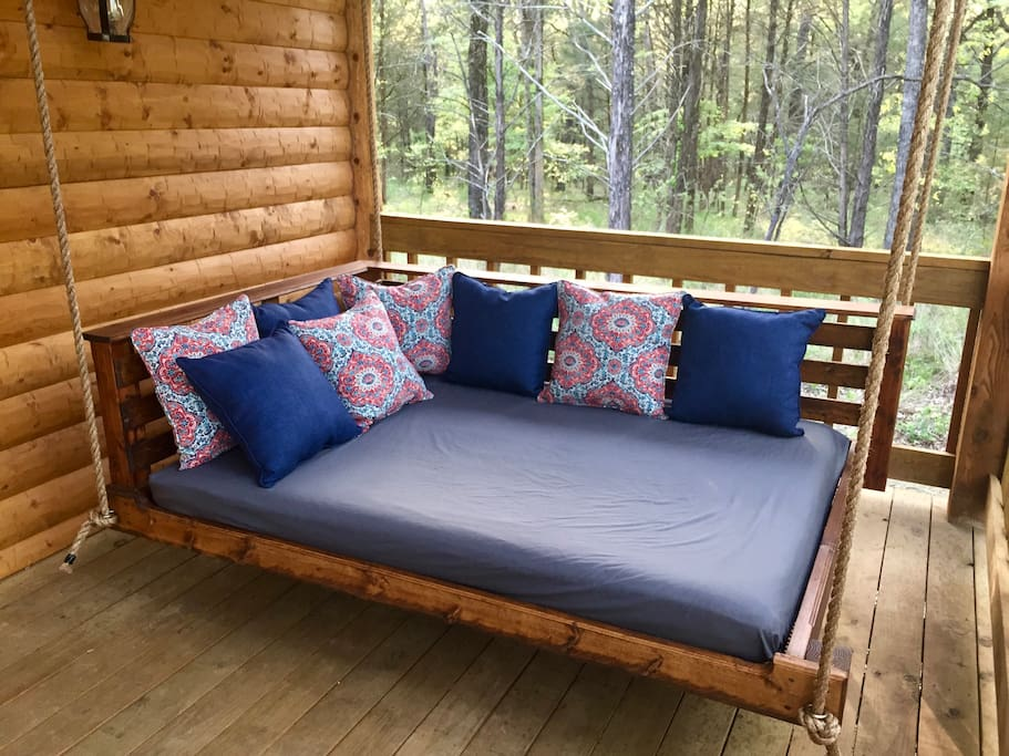 Relaxing bed swing on back porch