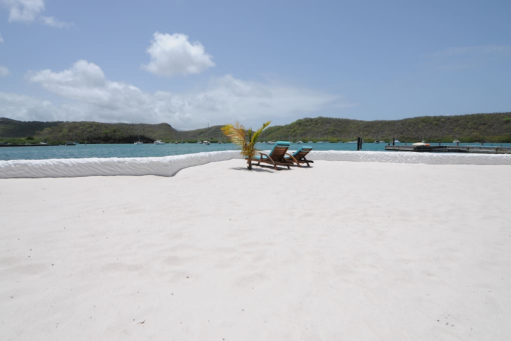 Private white sand man made beaches with plenty of sun loungers