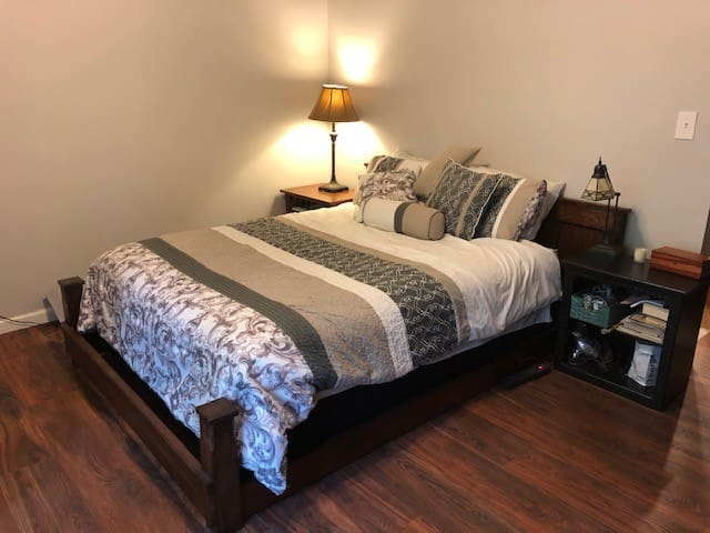 master bedroom with 2 huge closet spaces and a door to the back deck