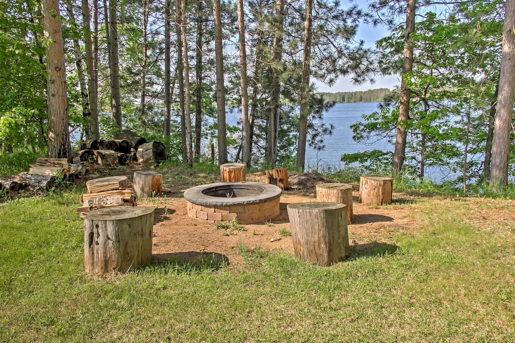 Tucked away among the white pines, this 3,100-square-foot home sleeps 8 and features stunning lake views from almost everywhere in the house.