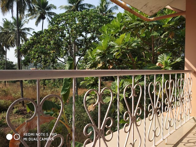 Balcony view Take a moment from your busy lives to breathe and feel healthy surrounded by lush greenery.