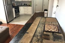 Custom table and long bench. Kitchen has plenty of counter space and storage
