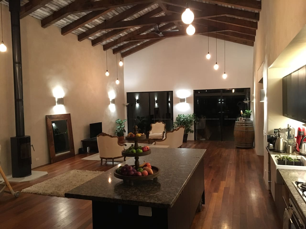 The open-plan living room / kitchen / dining room by night