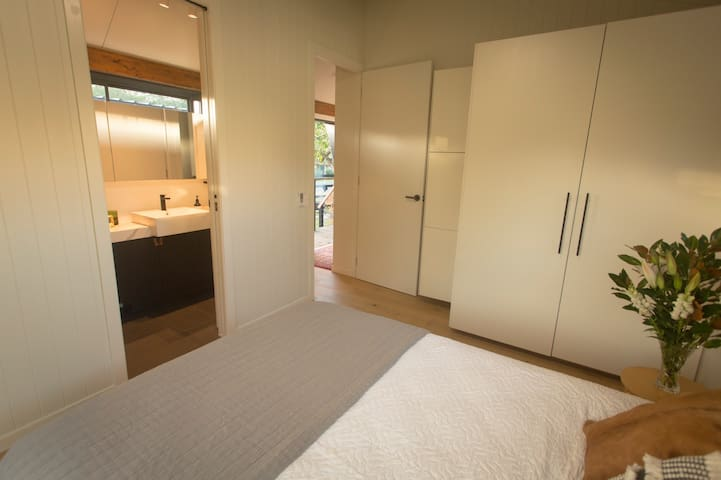 Master bedroom with access to main bathroom.