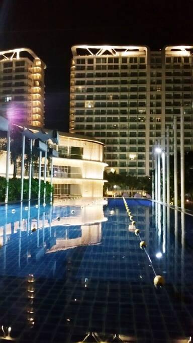 Paris Hilton Beach Club at night.