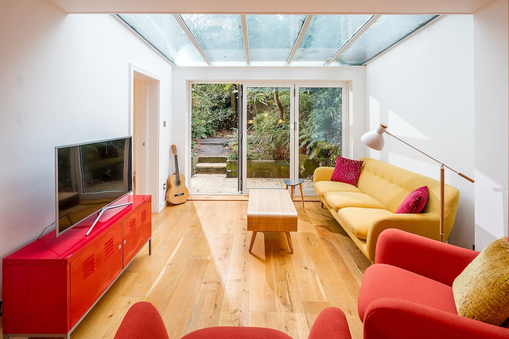 Welcome to our home! Our bright and beautiful living area with a huge sliding glass door.