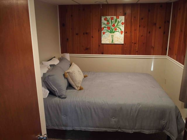 A cozy and cute bedroom with a queen bed provides a great nights sleep!