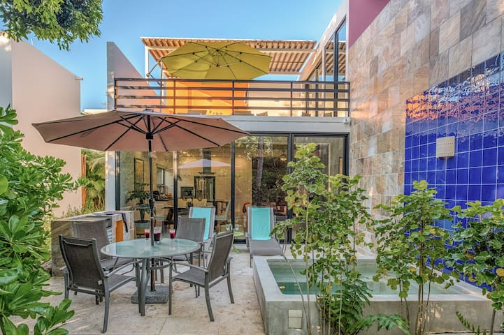 You can enjoy the exterior 'rooms' on either the upper or ground level terrace, which has a grill and ice well. (We have you covered on the charcoal, lighter fluid, and kitchenware for grilling.) Both terraces have lounge beds and a dining area.