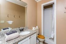 En suite master bathroom with walk in shower and double sinks.