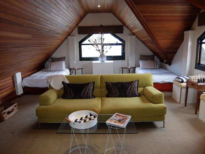 Luxury villa loft with poolside.