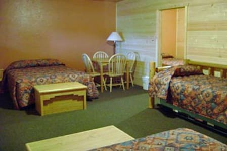 2 queens, a twin bed with a trundle  sleeps 6 in main area.  A table for four.