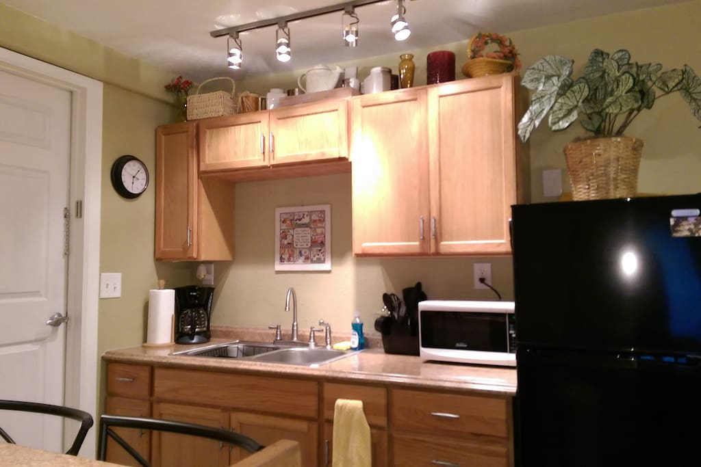Kitchenette with fridge, microwave, and coffee maker