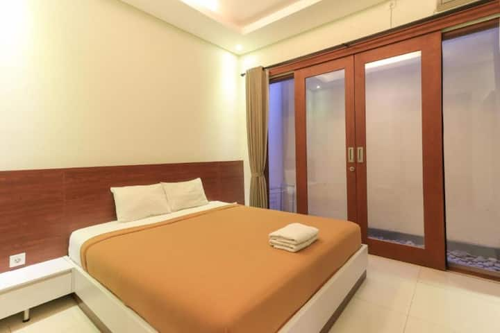 Comfy Deluxe Double Room at Pondok Adi Guest House