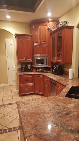 kitchen with cherry cabinets and microwave