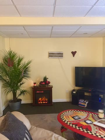 """Relax by the little fireplace.  """"talk"""" to the TV to play whatever your heart desires"""