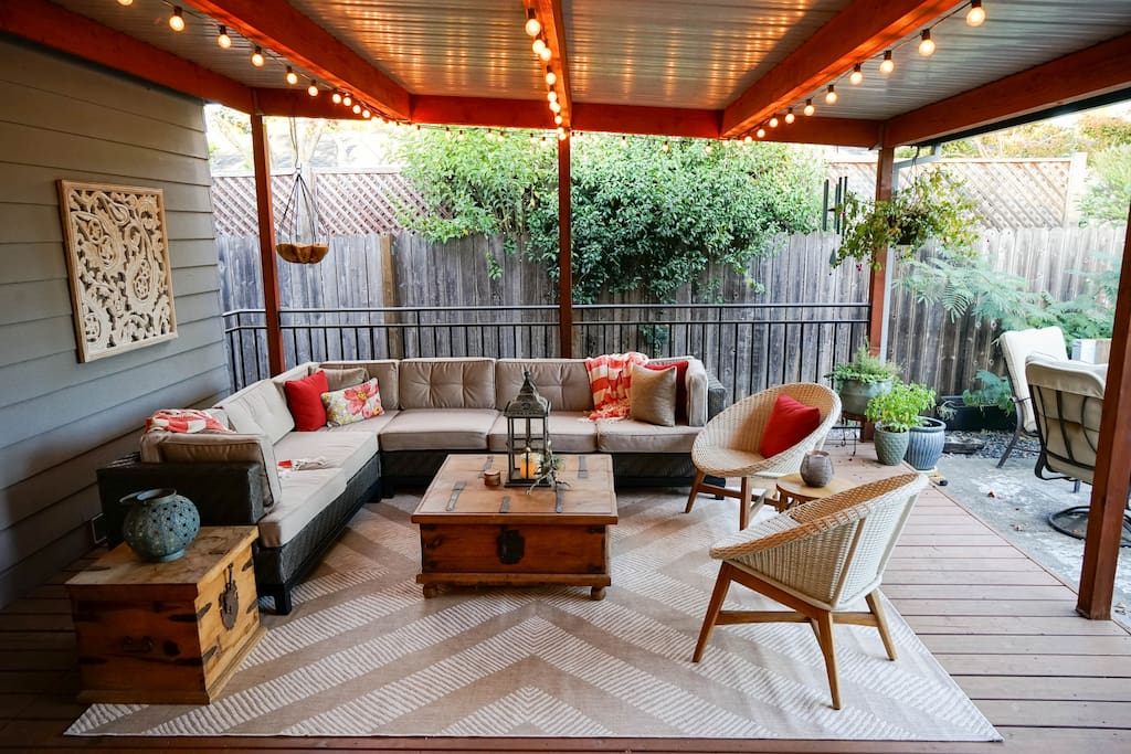 BoHo patio with market lights. Great for all seasons!