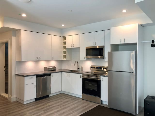 BRAND NEW! Centrally located 2 BR suite
