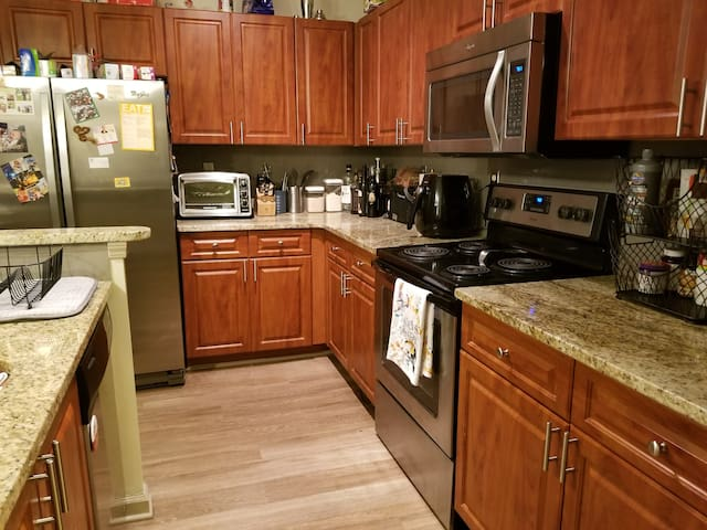 Kitchen, with electric tea pot, air fryer, and toaster oven.  An assortment of teas will be available.