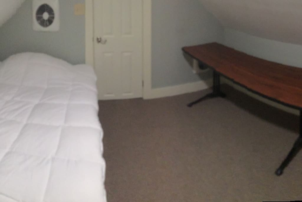 Full bed, memory foam mattress.  Table to work.  There is also a small nightstand and an office chair in the room.