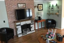 """Cozy up to the fireplace and watch a movie on the 55"""" TV"""