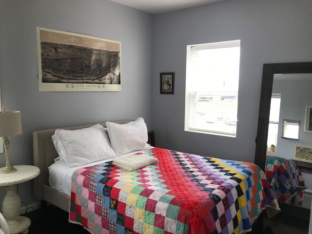2nd bedroom with queen bed and downtown view