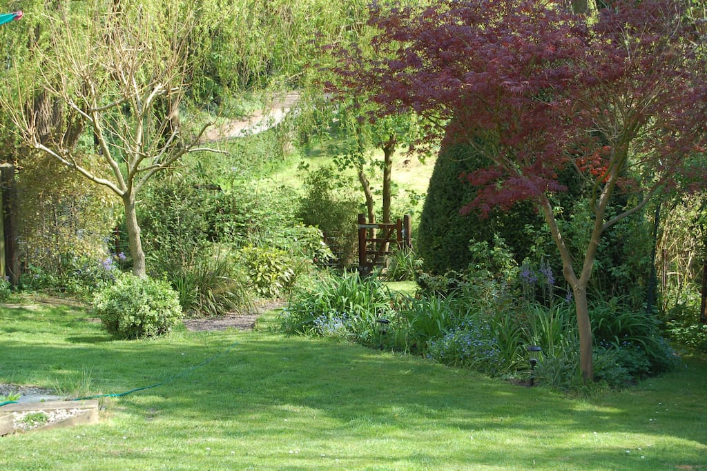 Set in 3/4 acre garden with mature trees, shrubs, roses and secured gated access to running brook