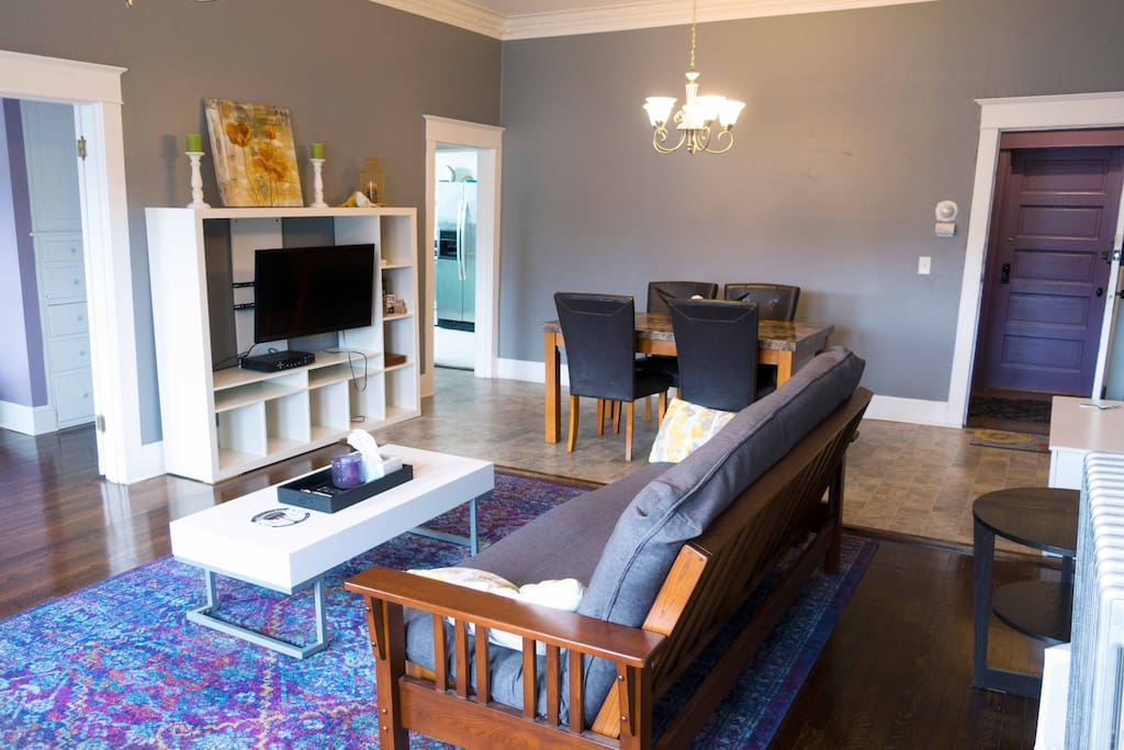 Living room, dining area with smart TV and a futon for an extra bed option.