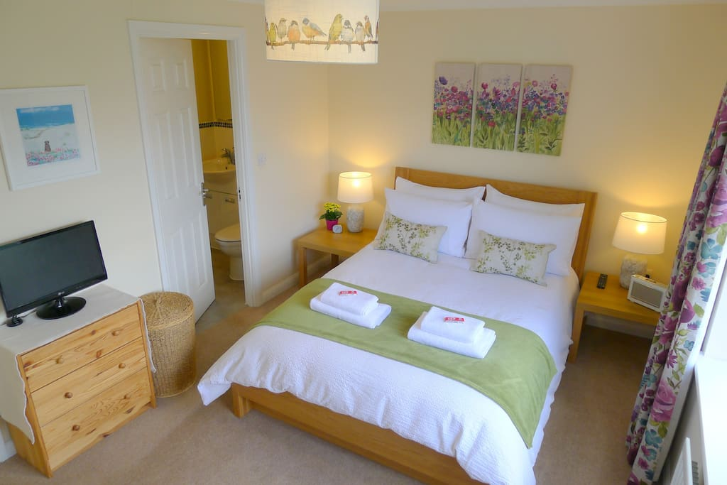 Very quiet and comfortable double room with TV, DAB radio, clock and hair dryer. Exclusive use of bright and modern en-suite shower room. The Airfield B&B - Duxford, Cambridge.