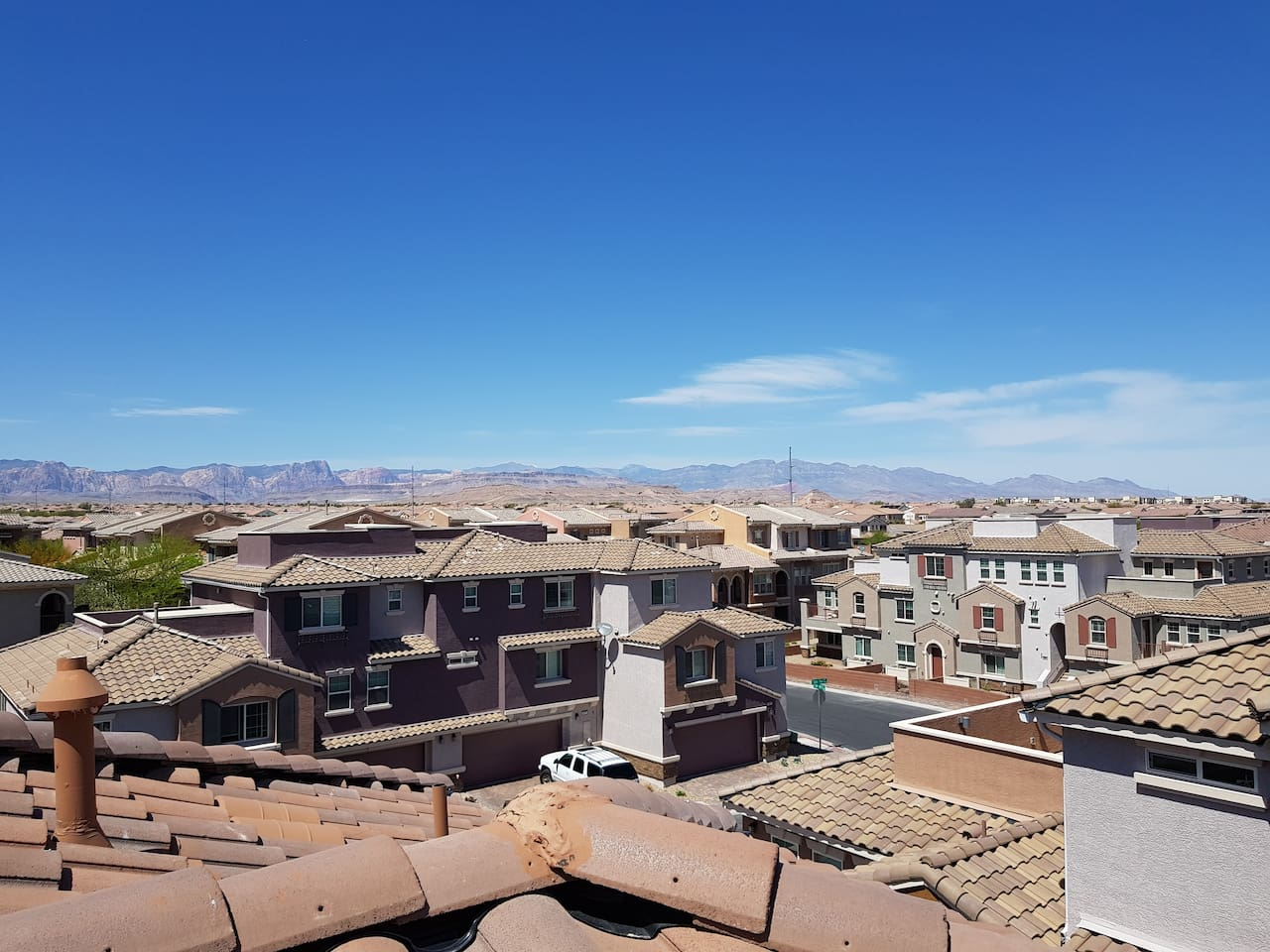 View from rooftop patio during the day.  It is a full 360-degree panorama view of the city and mountains.